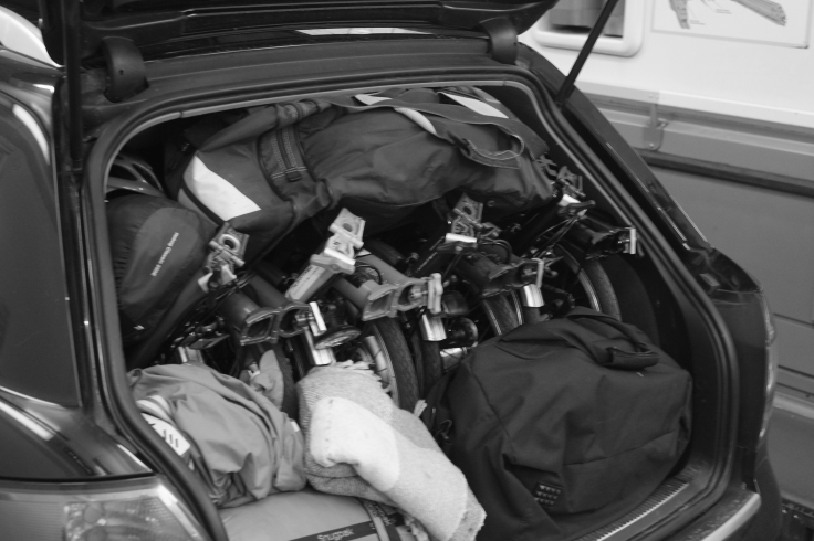 6. Four Bromptons Folding Bikes in the rea of Audi A4